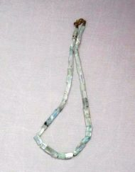 wearing crystals aquamarine necklace