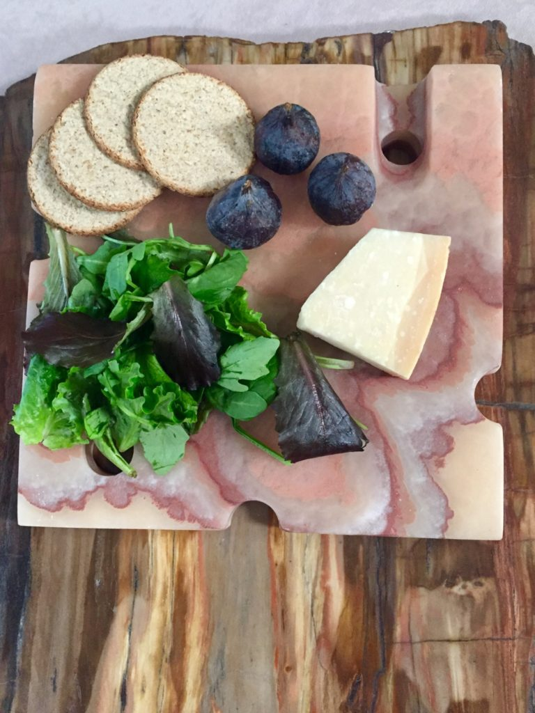 cheese board on fossil wood